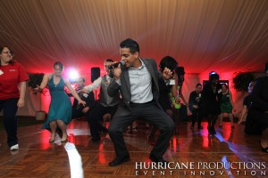 Vincent Velasquez on the dance floor at a tented, Rutgers event.
