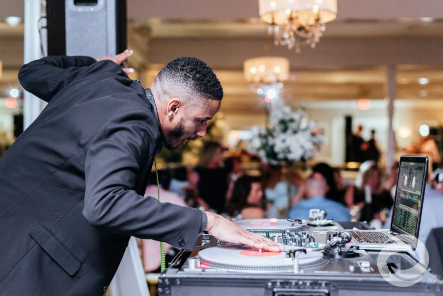 choosing your wedding dj | DJ Alvin Gay working the turntables